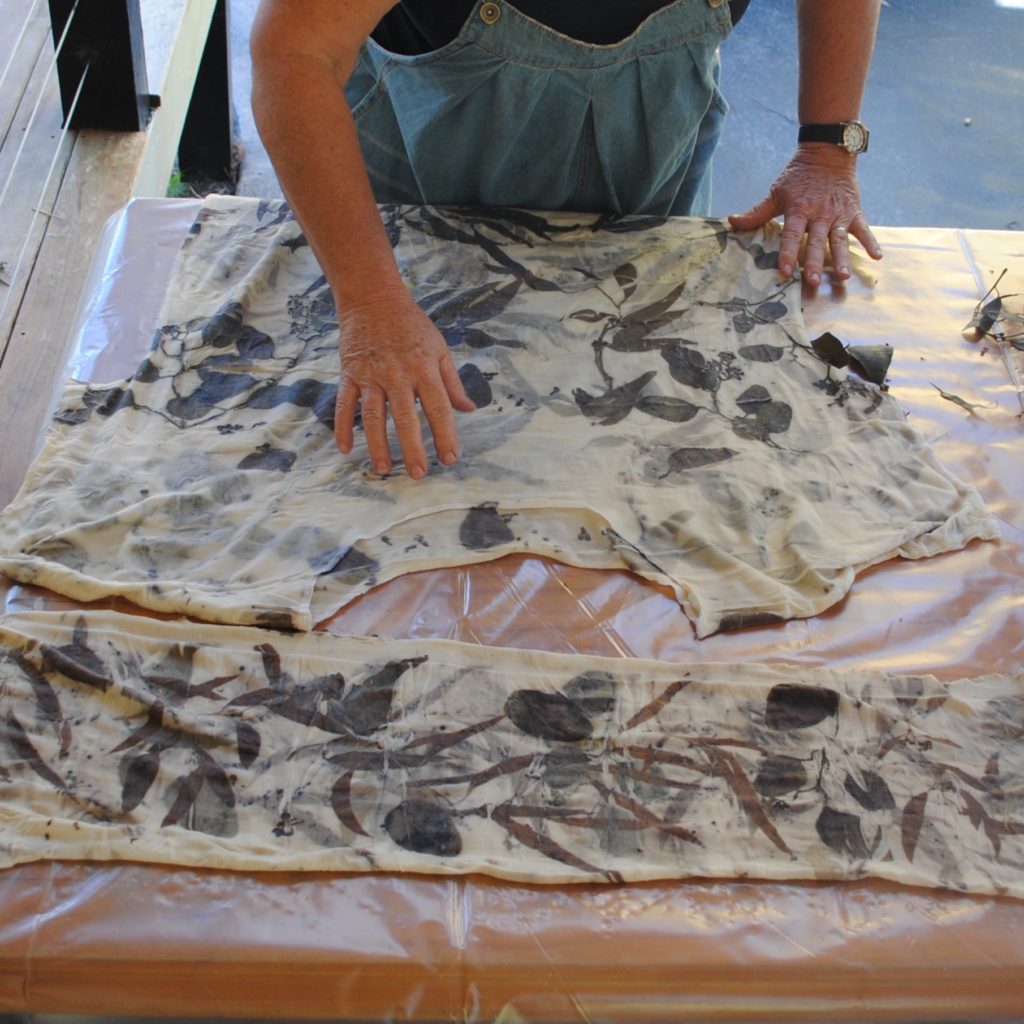 Eucalyptus leaf eco-printed clothing being unwrapped